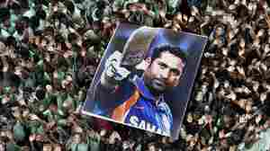 Students hold a poster of Indian cricketer Sachin Tendulkar in March at school in Chennai, southern India.