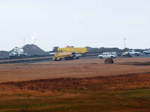 Cleanup went on Friday at the site of an oil pipeline leak and spill north of Tioga, N.D. Officials took nearly two weeks to tell the public about the break in a Tesoro Corp. pipeline.