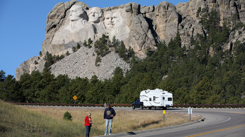 Tourists stop on the roadside near Mount Rushmore, after their visit was canceled due to the government shutdown. South Dakota and other states have reached an agreement to fund operations to reopen the parks.