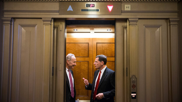 "Sen. Chuck Schumer (D-NY), left, seen here speaking with Sen. John Barrasso (R-WY) in an elevator Sunday, says that undoing the sequester cuts is ""one of the sticking points"" in budget talks. Congress is struggling to find a solution to end the government shutdown, now in its thirteenth day."