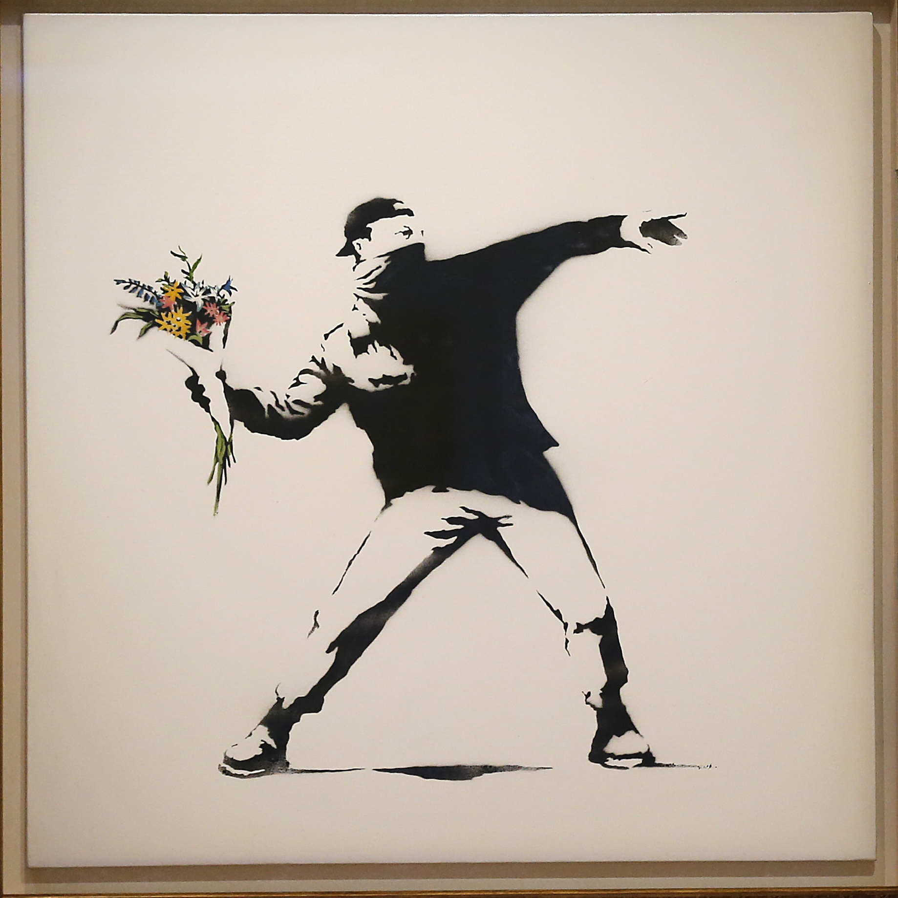 "A limited edition of Banksy's ""Love Is in the Air"" sold for $249,000 at Bonhams auction house in London this summer. The artist offeed a version of the work for $60 on the sidewalk in New York Saturday."
