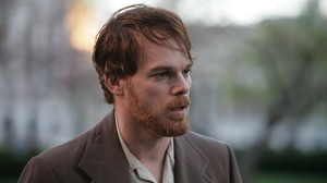 Carr's formidable charisma becomes something of a problem when David (Michael C. Hall), his former lover and professor, won't let go.