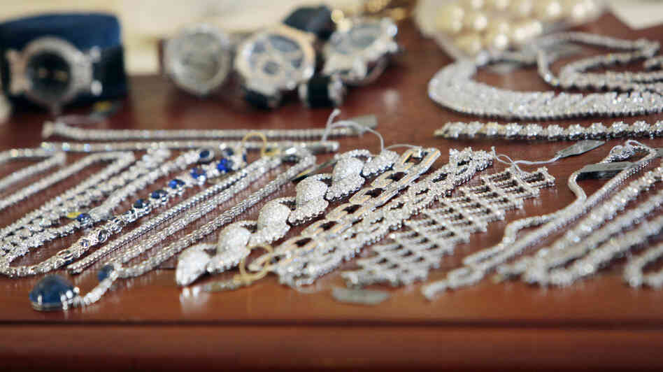 Police display some of the jewelry recovered from the 2008 robbery of Harry Winston jewelers in Paris. Thieves snatched loot estimated to be worth $105 million.