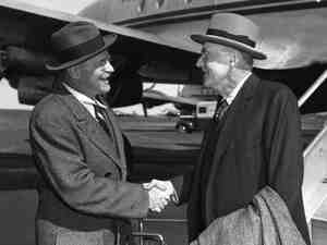 John Foster Dulles (right) is greeted by his brother Allen Welsh Dulles on his ar