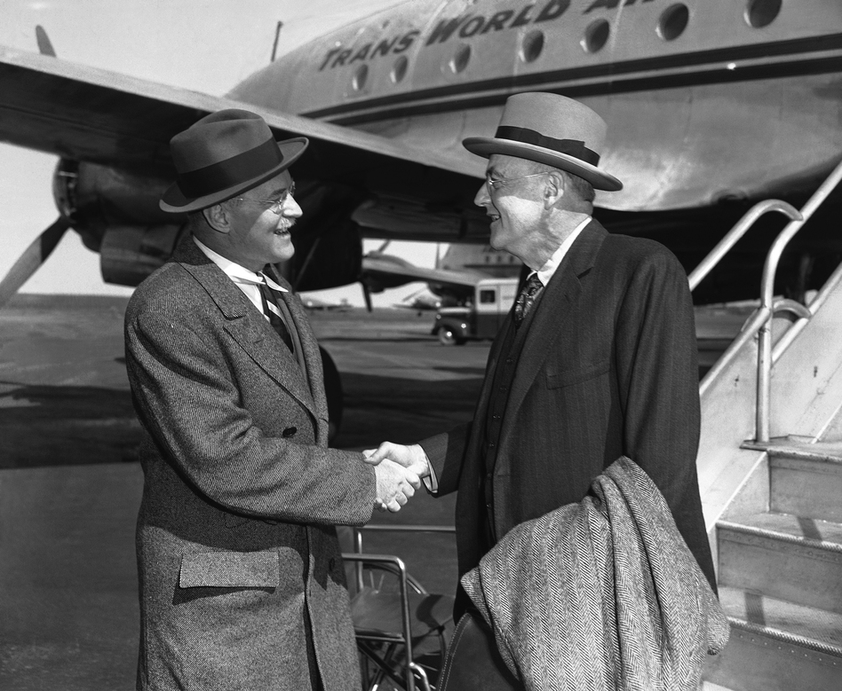 122b101d7f John Foster Dulles (right) is greeted by his brother Allen Welsh Dulles on  his