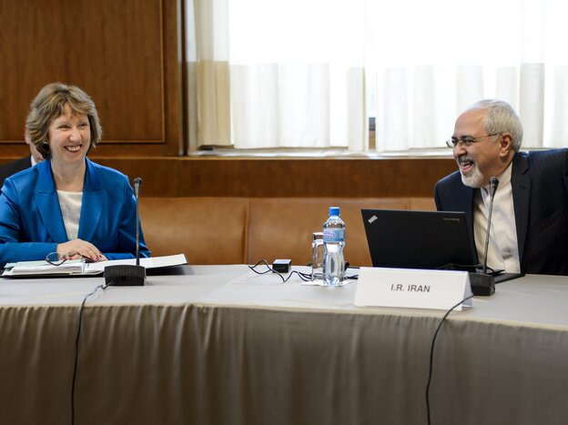 Catherine Ashton, the EU high representative for foreign affairs, and Iranian Foreign Minister Mohammad Javad Zarif share a light moment Tuesday at the start of two-day talks on Iran's nuclear program.