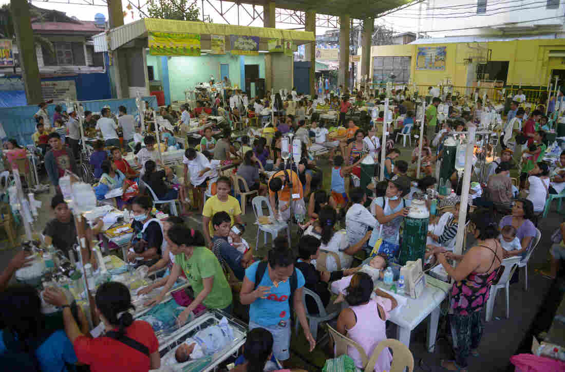Patients are treated at a temporary shelter following a 7.1 magnitude quake that struck near Cebu in the Philippines on Tuesday. Many churches and hospitals were damaged by the quake.
