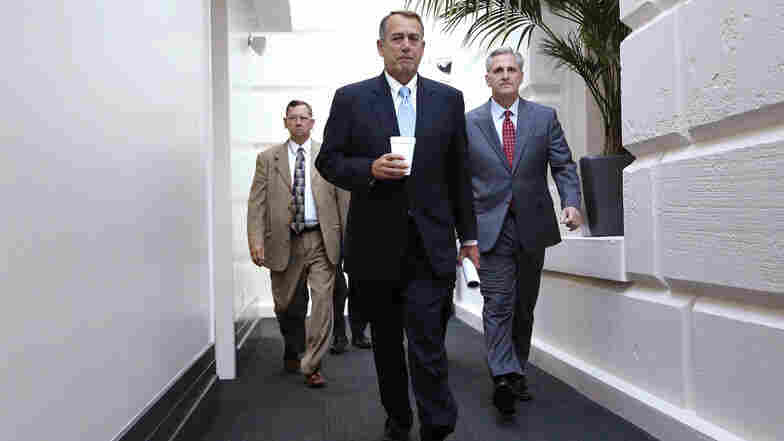 House Speaker John Boehner (center) and House Majority Whip Rep. Kevin McCarthy (right) arrive for a Republican caucus meeting at the U.S. Capitol.