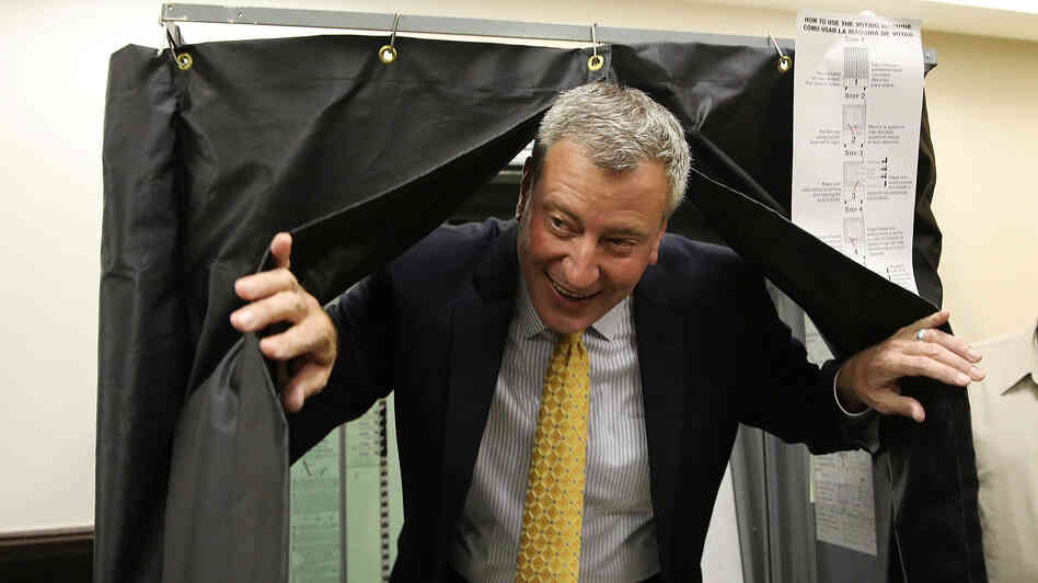 Bill de Blasio emerges from a voting booth on Sept 10.