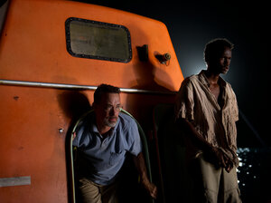 Tom Hanks and Barkhad Abdirahman share close quarters in Captain Phillips.