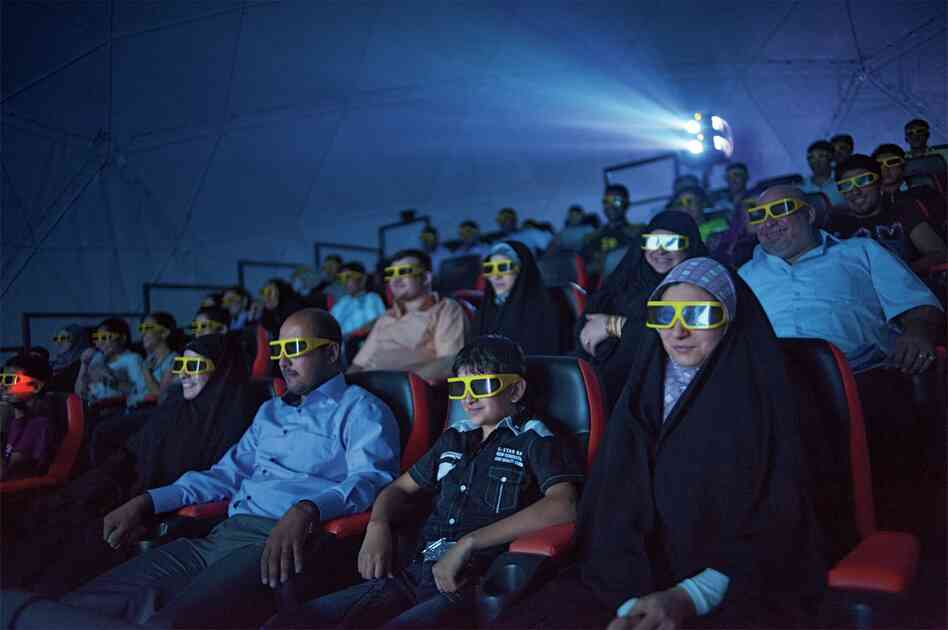Moviegoers thrill to shaking seats and wind machines during a 3-D film at a theater closed during the war.