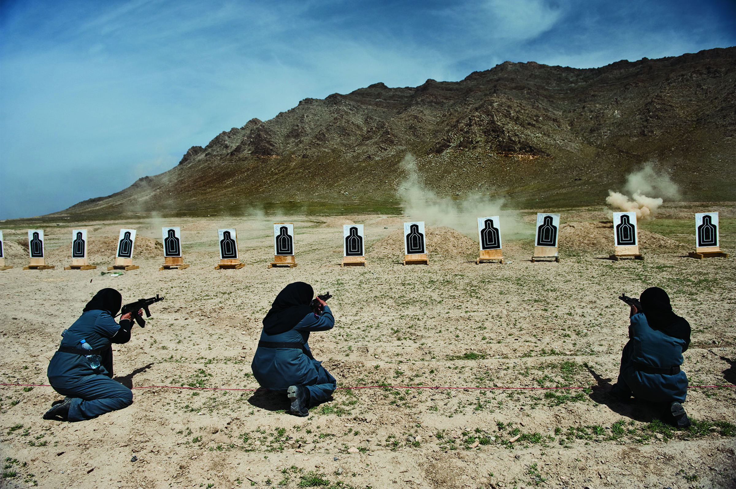 Women -- mostly widows -- train for police force jobs at a firing range near Kabul.