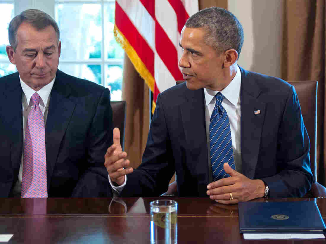 House Speaker John Boehner listens as President Obama delivers a statement on Syria during a meeting with members of Congress at the White House on Sept. 3.