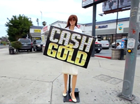 A sign-waving mannequin, a still from a promotional YouTube video.