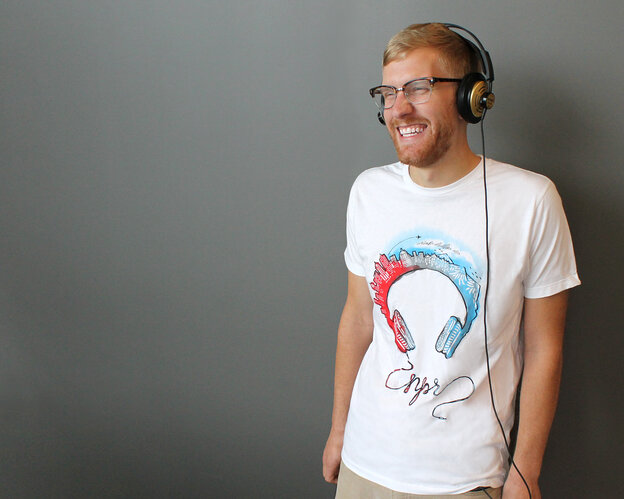 "NPR Marketing, Branding and Communications intern Johnny Kauffman took a turn as a shirt model to show off the newest NPR tee. It features the winning design from the NPR + Threadless ""My Sound World"" challenge."
