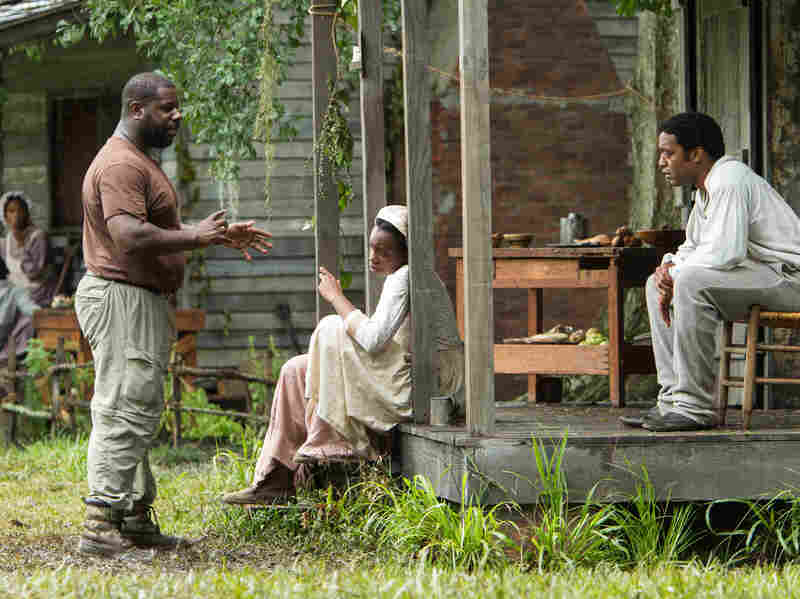 Director Steve McQueen (left) works with actors on the set of 12 Years A Slave. The film was shot on a Louisiana plantation that sits next door to where Solomon Northup spent his years as a slave.
