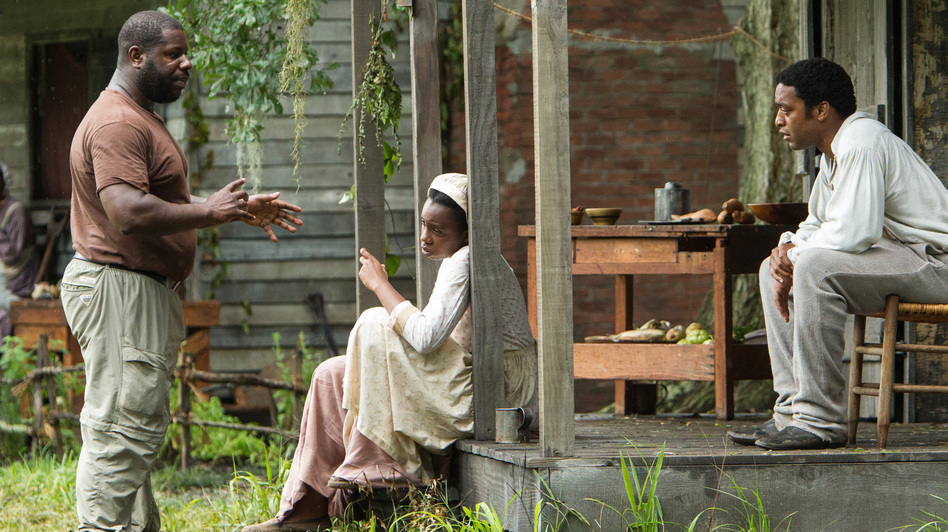 Director Steve McQueen (left) works with actors on the set of 12 Years A Slave. The film was shot on a Louisiana plantation that sits next door to where Solomon Northup spent his years as a slave. (Fox Searchlight Pictures)