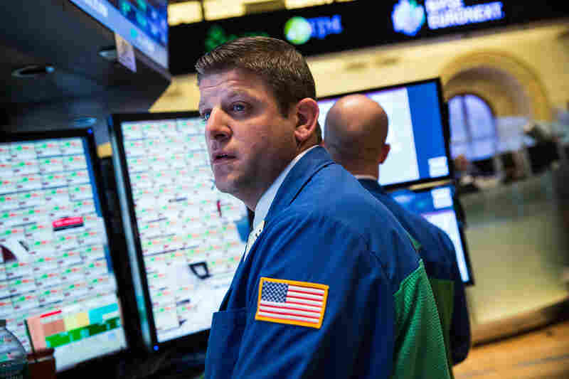 A trader works on the floor of the New York Stock Exchange on Oct. 2. The Dow Jones Industrial Average slid 58 points, as the shutdown continued into its second day.