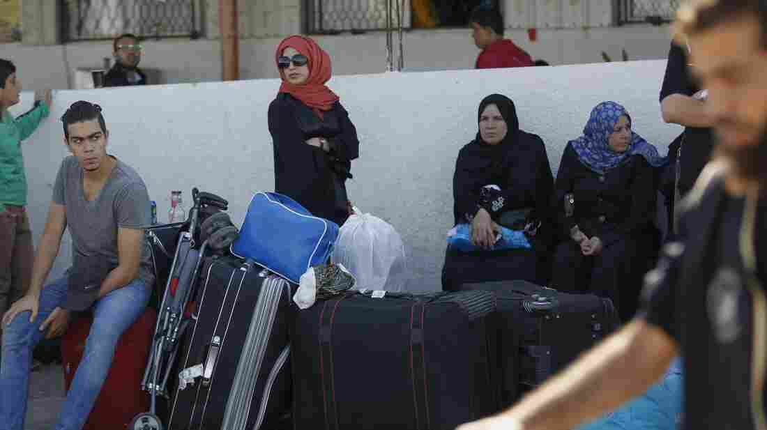 Palestinian travelers wait to cross into Egypt at the Rafah crossing terminal in the southern Gaza Strip earlier this month.
