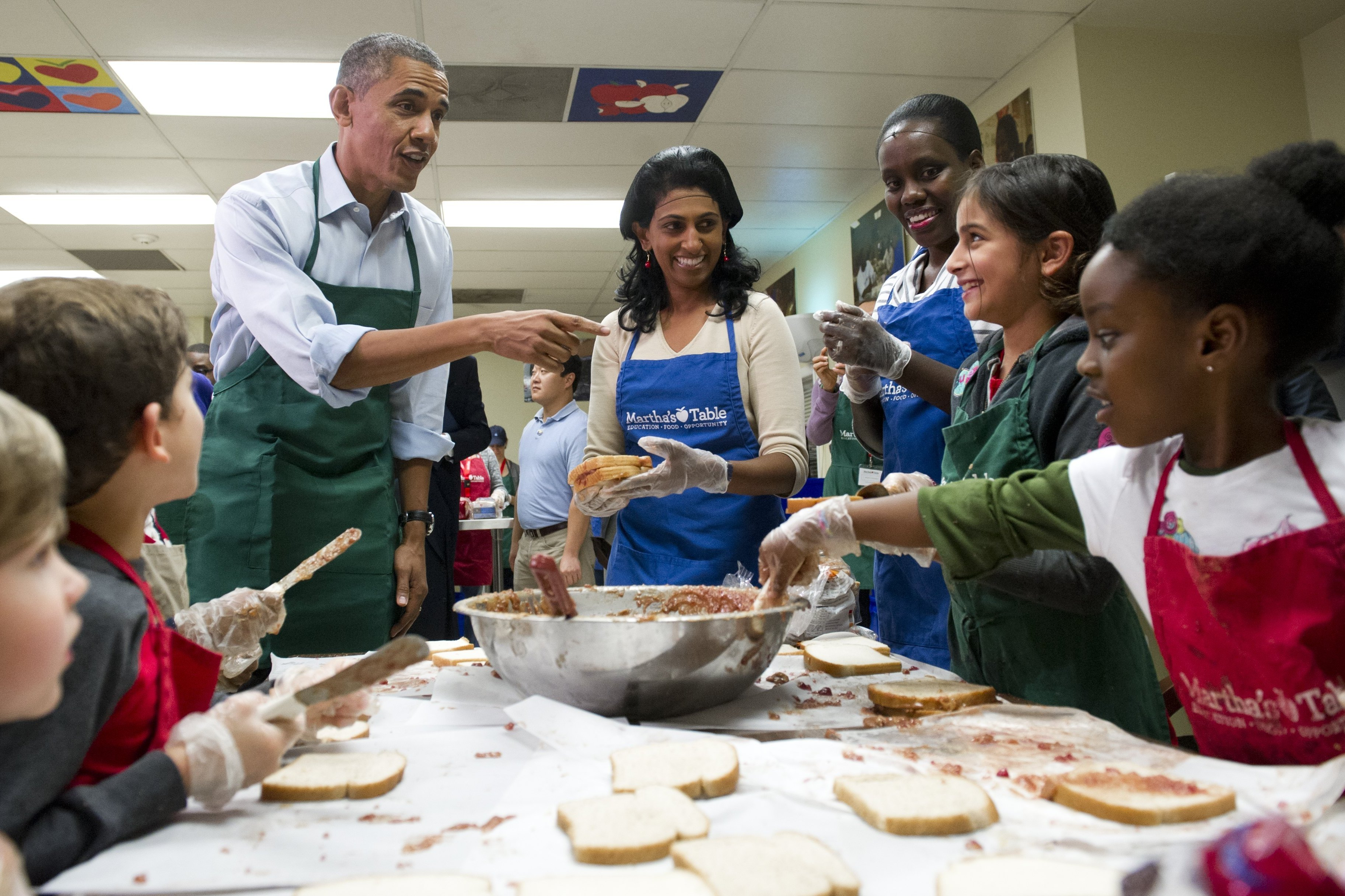President Obama talks with children and adult volunteers at Martha's Table in Washington, D.C., on Monday. The nonprofit organization helps low-income and homeless families. Many of the volunteers over the past couple weeks were furloughed federal workers.