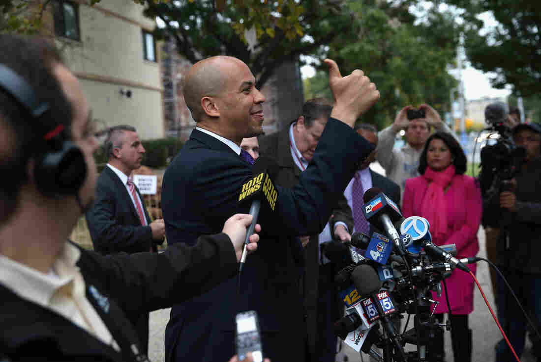 Newark Mayor Cory Booker greets a supporter after casting his vote in a special U.S. Senate election on Wednesday in Newark, New Jersey.