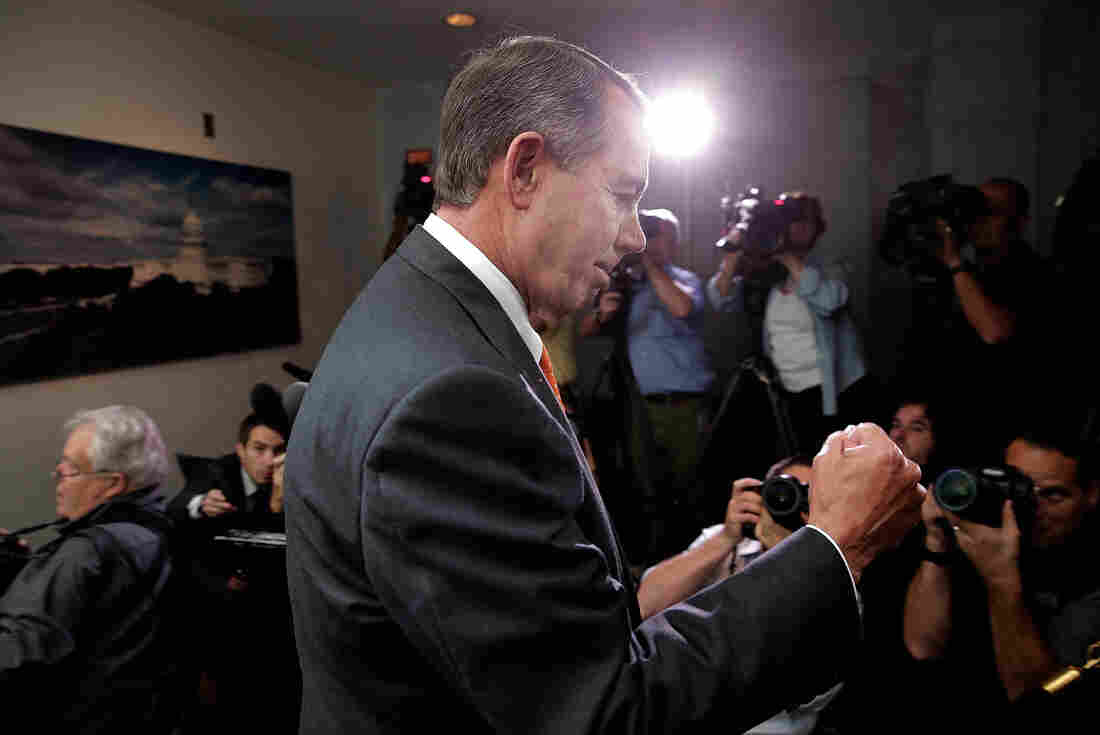 Speaker of the House John Boehner pumps his fist after leaving a meeting of House Republicans at the U.S. Capitol on Wednesday.