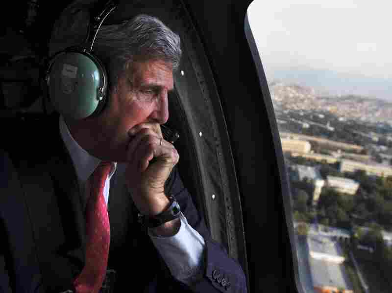 Secretary of State John Kerry flies over Afghanistan on Oct. 11. He met with President Hamid Karzai to work out an agreement on U.S. presence in the country.