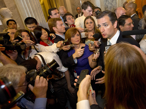 Reporters surround Sen. Ted Cruz after he finished his marathon speech.