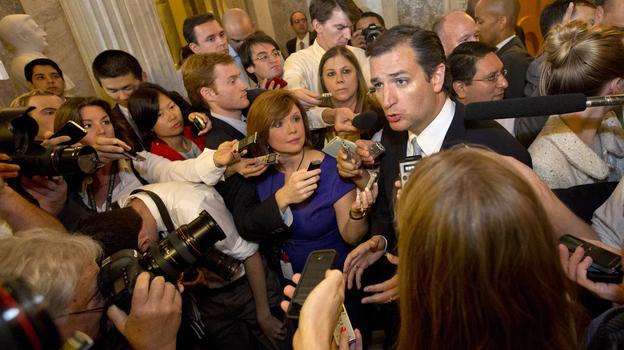 Reporters surround Sen. Ted Cruz after he finished his marathon speech. (AP)