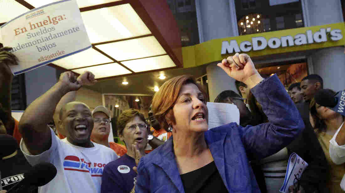 New York City Council speaker and then-mayoral candidate Christine Quinn speaks at a fast-food workers' protest outside a McDonald's in New York in August. A nationwide movement is calling for raising the minimum hourly wage for fast-food workers to $15.