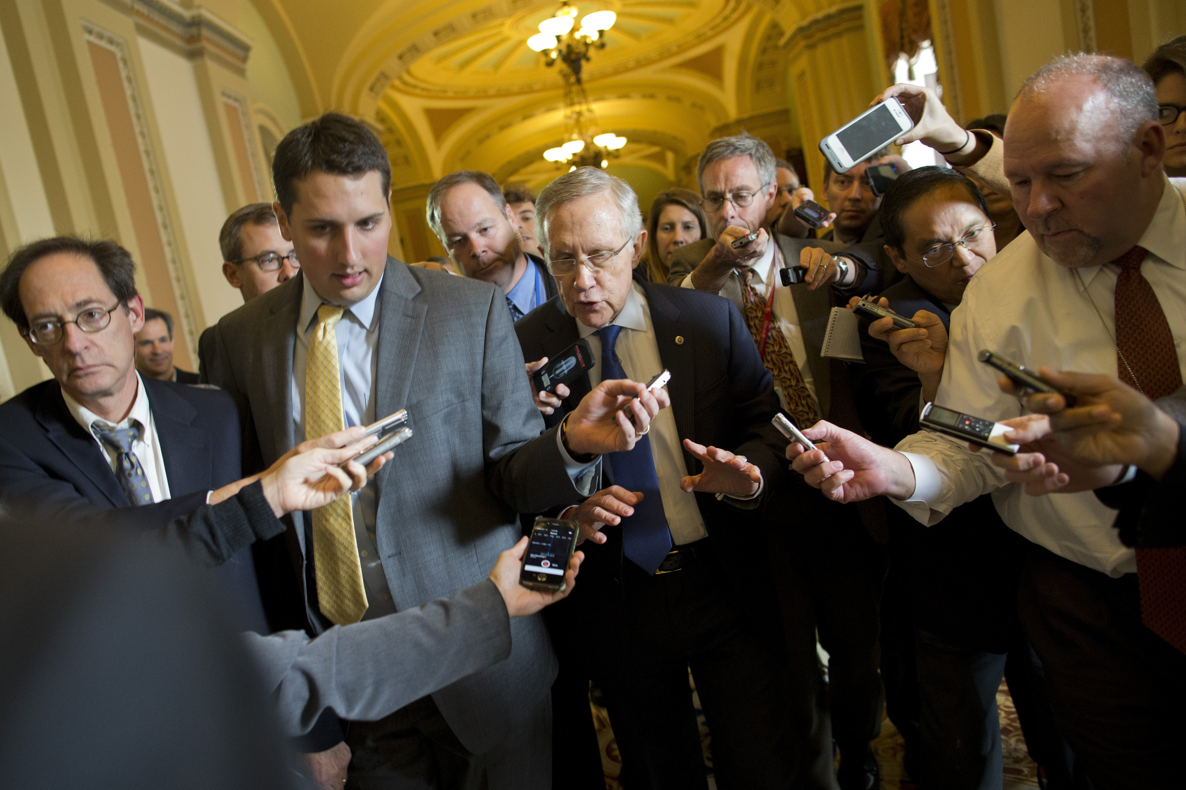 Senate Majority Leader Sen. Harry Reid, D-Nev., is surrounded by reporters after leaving the office of Senate Minority Leader Sen. Mitch McConnell, R-Ky., on Capitol Hill on Monday.