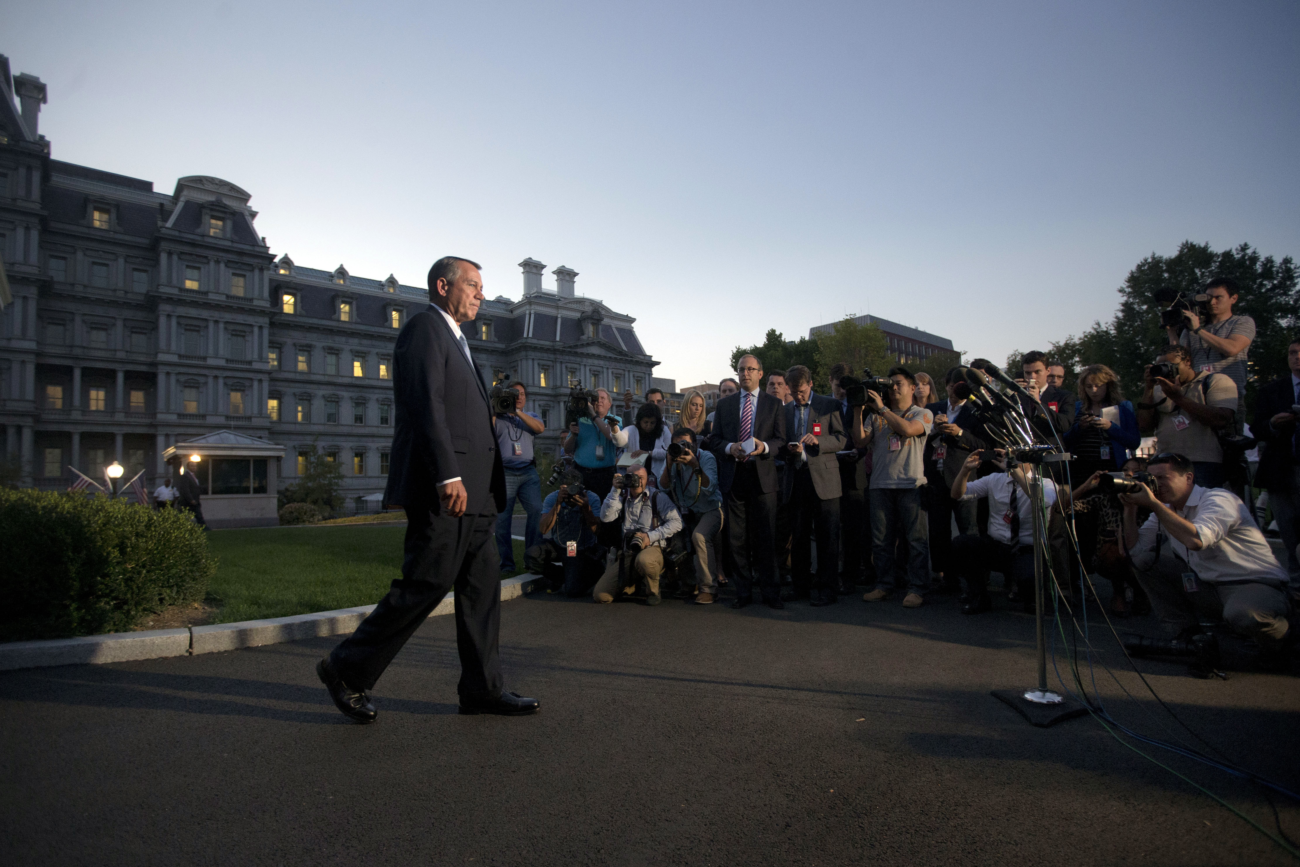House Speaker John Boehner, R-Ohio, walks out of the White House to speak to members of the media after meeting with President Obama on Oct. 2.