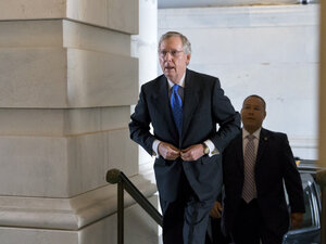 Senate Minority Leader Mitch McConnell arrives at the Capitol on Wednesday. The Kentucky Republican helped forge a late-hour deal with Senate Majority Leader Harry Reid to sidestep financial chaos.