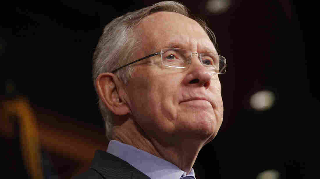 Senate Majority Leader Harry Reid of Nevada listens to a reporter's question about a meeting with Senate Republicans.