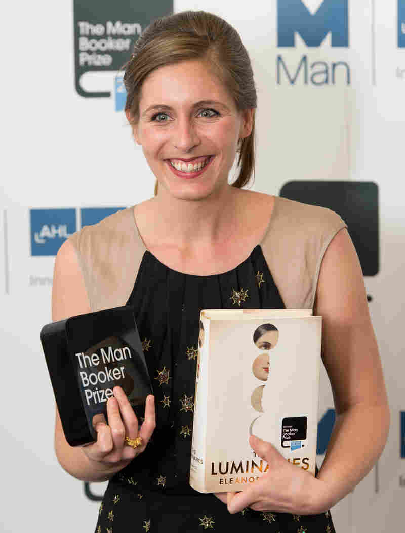 Eleanor Catton, author of The Luminaries poses for photographs Tuesday after winning the 2013 Man Booker Prize for Fiction at The Guildhall in London.