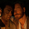 Chiwetel Ejiofor (left) plays Solomon Northup, a New York freeman kidnapped into slavery in 1841 and eventually resold to plantation owner Edwin Epps (Michael Fassbender).