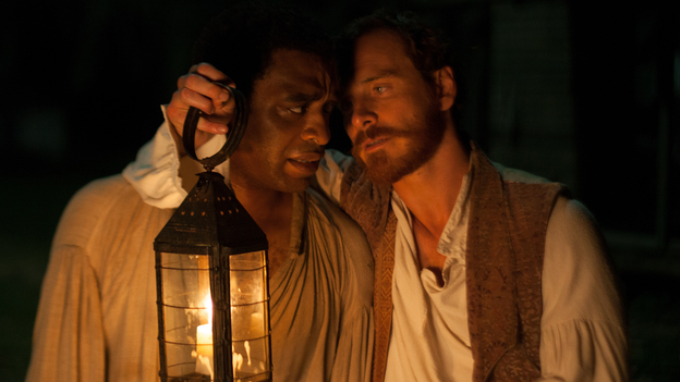 Chiwetel Ejiofor (left) plays Solomon Northup, a New York freeman kidnapped into slavery in 1841 and eventually resold to plantation owner Edwin Epps (Michael Fassbender). (Fox Searchlight Pictures)