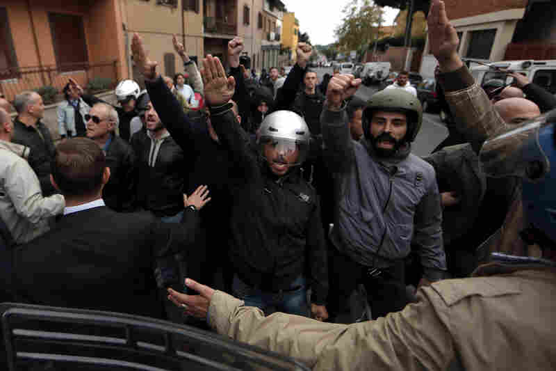 Priebke supporters shout slogans after the hearse carrying his coffin arrived in Albano Laziale.