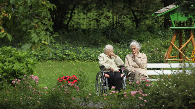 Two German women chat in the gardens of a senior care home in Berlin. Germany is grappling with a rapidly aging population: By 2050, almost a