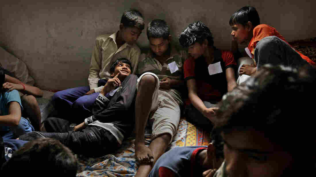 Child laborers wait to be processed at a safe house after being rescued during a raid at a factory in New Delhi by workers from Bachpan Bachao Andolan (Save the Childhood Movement) in June.