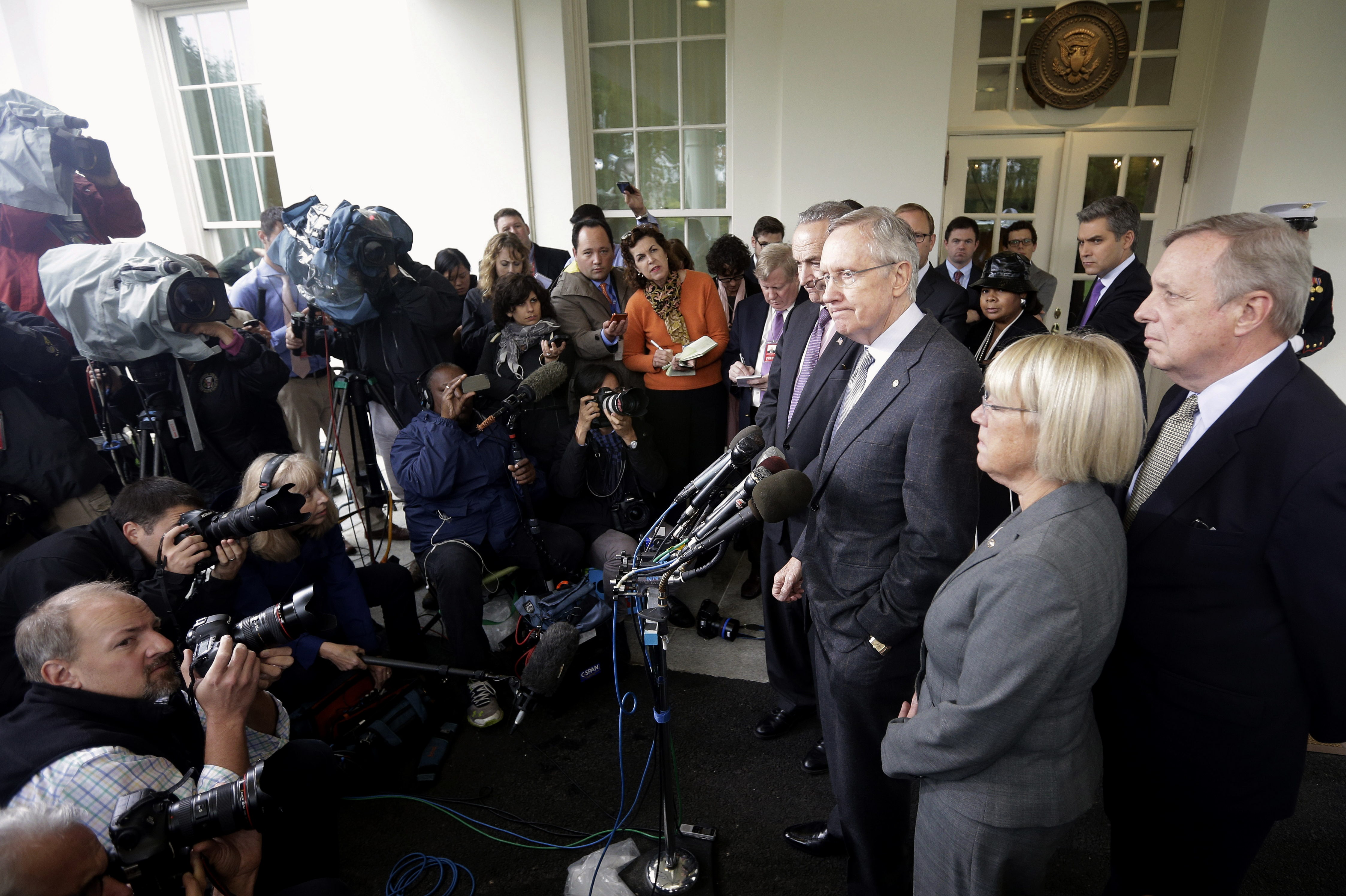 Senate Majority Leader Harry Reid, D-Nev., flanked by Sen. Charles Schumer, D-N.Y., Senate Budget Committee Chair Patty Murray, D-Wash., and Senate Majority Whip Richard Durbin, D-Ill., speaks to members of the media outside the West Wing of the White House on Oct. 10.