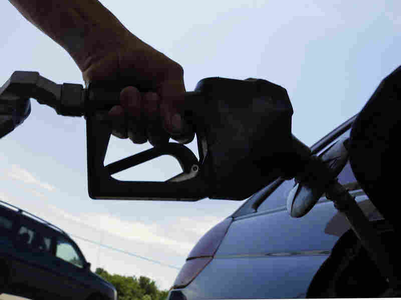 A motorist fuels up at a service station in Springfield, Ill.