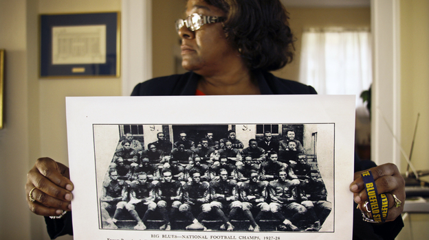 Deirdre Guyton, the school's director of alumni affairs, is proud of Bluefield State College's history and wants to preserve it. Here, she holds up a photo of the school's football team from 1927 to 1928, when it was the best black college team. (NPR)
