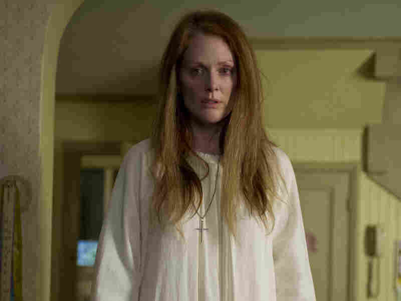 Julianne Moore takes on the problematic-parent in the remake — complete with long wild hair and a white nightgown reminiscent of Piper Laurie's in the original film.