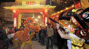 Members of the Chinese community in India, gather at the 'city gates' as they perform a dragon dance during the celebration of the Lunar New Year in Chinatown in Kolkata, India, on Feb. 2, 2011.
