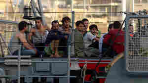 Migrants arrive in Valletta, the Maltese capital, aboard a patrol boat on Oct. 12, a day after their boat sank, killing more than 30 people, mostly women and children — just the latest deadly migrant tragedy to hit the Mediterranean. Despite Europe's financial crisis illegal immigrants continue to attempt to enter Europe through its southern coastal countries as they seek a better life.