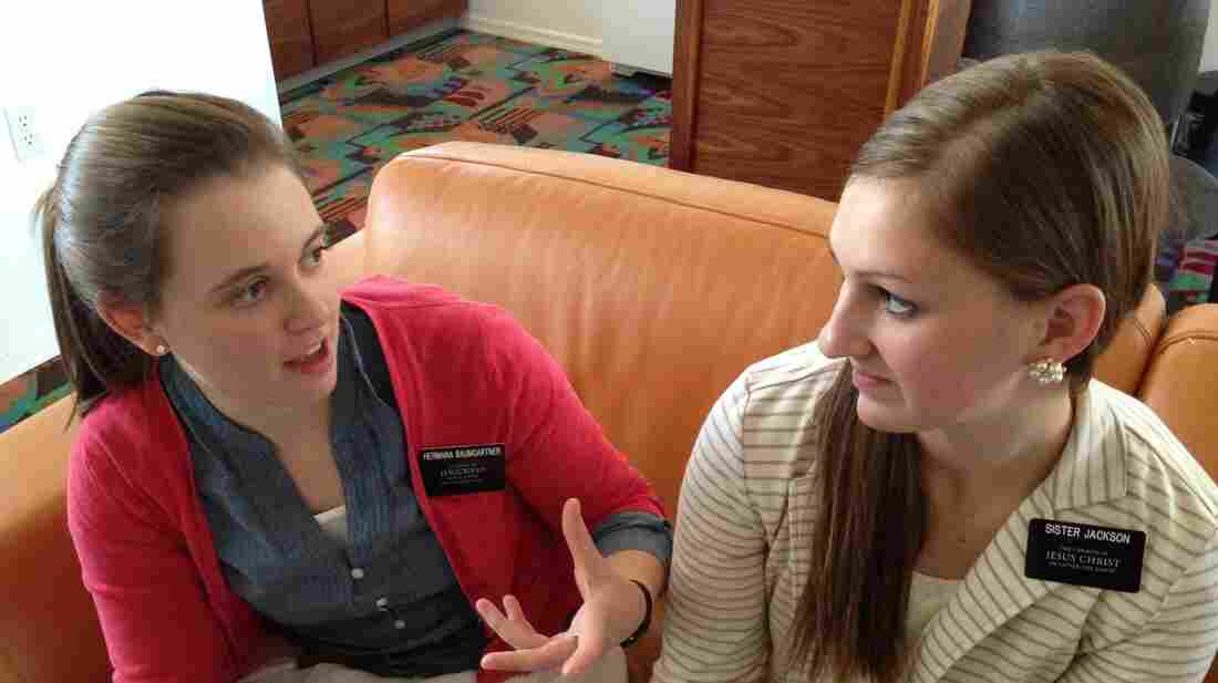 Alisa Baumgartner chats with fellow missionary Andrea Jackson. Jackson, 19, is taking 18 months off from college to do mission work.