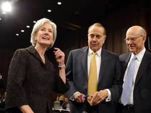 Kathleen Sebelius stands with Sen. Pat Roberts (right), R-Kan., and former Senate Majority Leader Bob Dole in 2009.