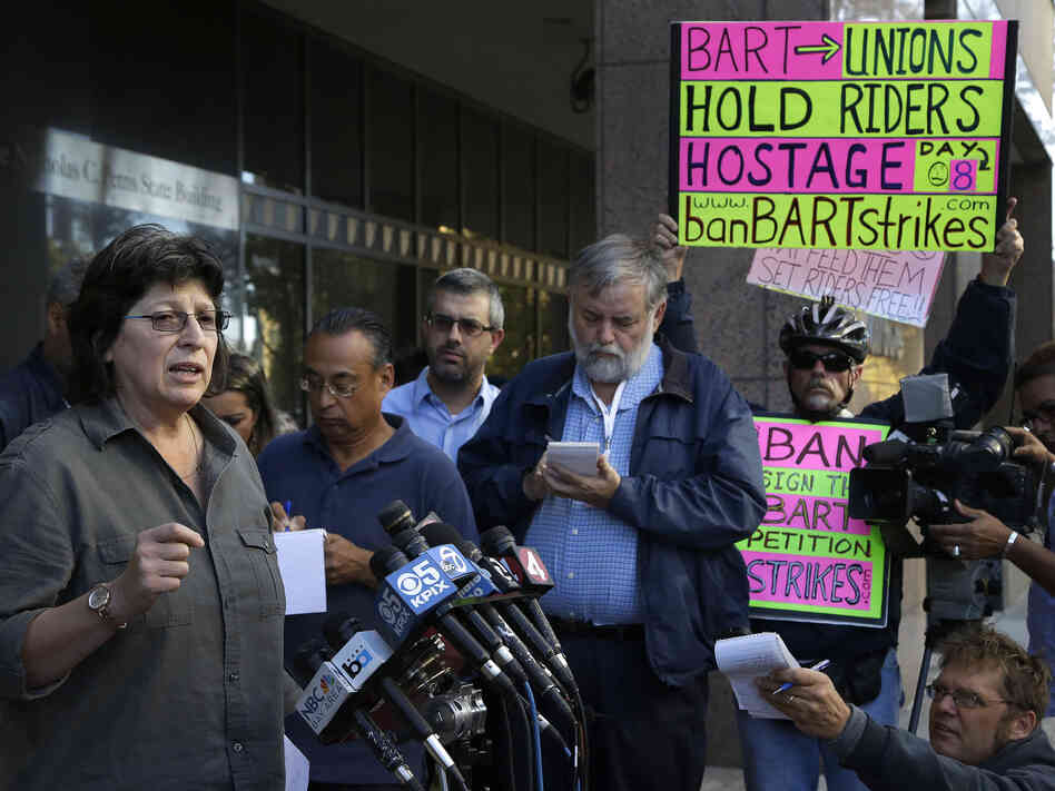 Roxanne Sanchez (left), president of Service Employees International Union Local 1021, speaks during a news conference in Oakland, Calif., on Thursday.