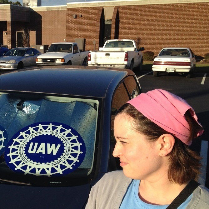 Lauren Feinauer works at the Chattanooga plant. She props UAW signs in the windshield and rear window while she's parked at work.
